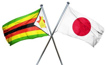 zimbabwe: bandera de Zimbabwe combinado con la bandera de Jap�n Foto de archivo