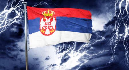 serbia flag: Serbia flag, 3D rendering, crisis concept storm cloud