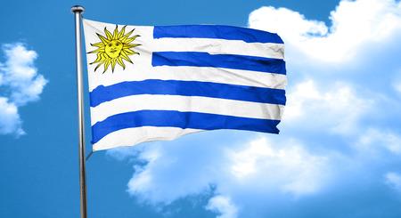 bandera uruguay: Uruguay bandera ondeando en el viento Foto de archivo