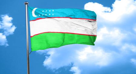 uzbekistan: Uzbekistan flag waving in the wind Stock Photo