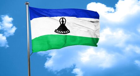 LESOTHO: Lesotho flag waving in the wind Stock Photo