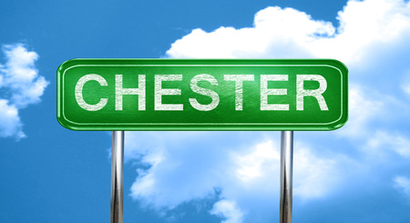 chester: chester city, green road sign on a blue background Stock Photo