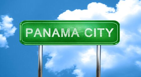 panama city: panama city city, green road sign on a blue background Stock Photo