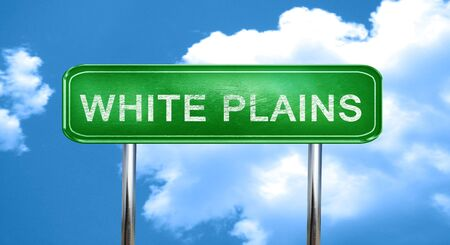 plains: white plains city, green road sign on a blue background Stock Photo