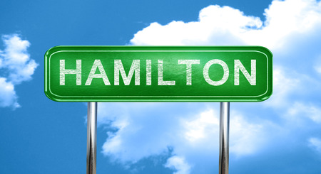 hamilton: hamilton city, green road sign on a blue background
