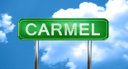 carmel: carmel city, green road sign on a blue background Stock Photo