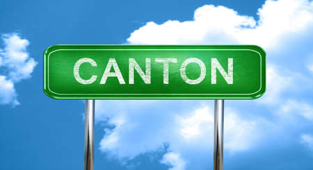 canton: canton city, green road sign on a blue background Stock Photo