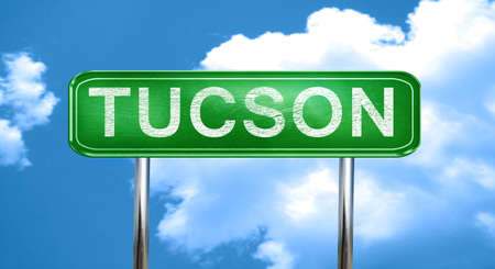tucson: tucson city, green road sign on a blue background Stock Photo