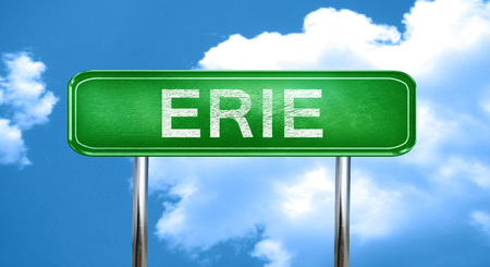 erie city, green road sign on a blue background