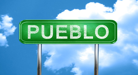pueblo city, green road sign on a blue background