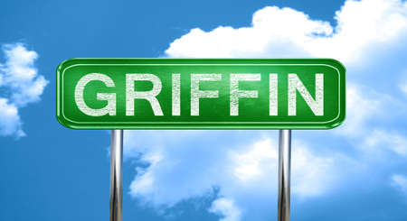 griffin: griffin city, green road sign on a blue background Stock Photo