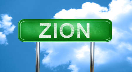 zion city, green road sign on a blue background