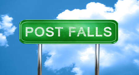 sign post: post falls city, green road sign on a blue background