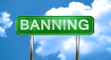 banning city, green road sign on a blue background Stock Photo