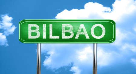 bilbao: Bilbao city, green road sign on a blue background