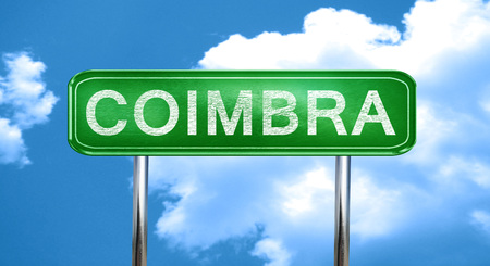 Coimbra city, green road sign on a blue background