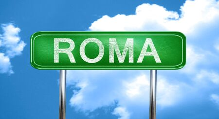 roma: Roma city, green road sign on a blue background Stock Photo
