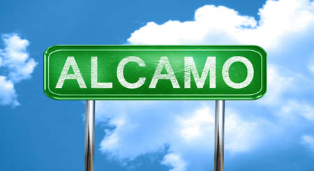 Alcamo city, green road sign on a blue background Stock Photo