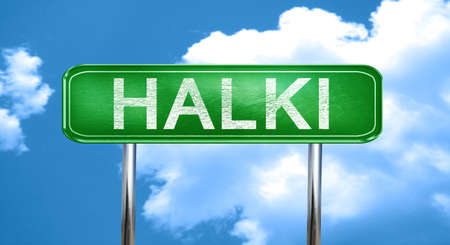 halki: Halki city, green road sign on a blue background Stock Photo