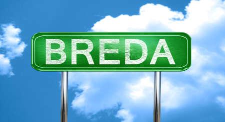 breda: Breda city, green road sign on a blue background