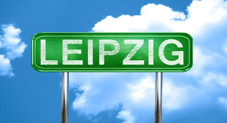 leipzig: Leipzig city, green road sign on a blue background Stock Photo