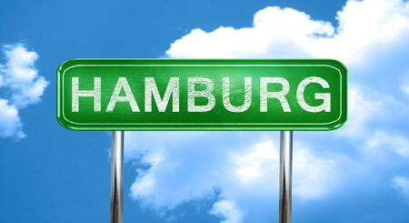 hamburg: Hamburg city, green road sign on a blue background Stock Photo