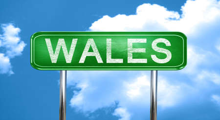 wales: Wales city, green road sign on a blue background