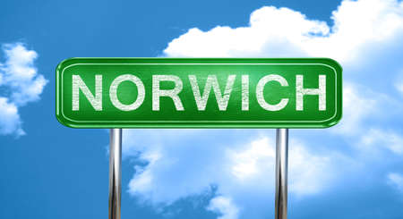 Norwich city, green road sign on a blue background