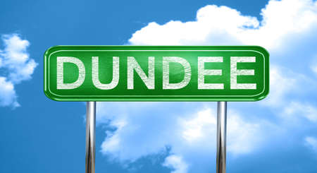 dundee: Dundee city, green road sign on a blue background Stock Photo