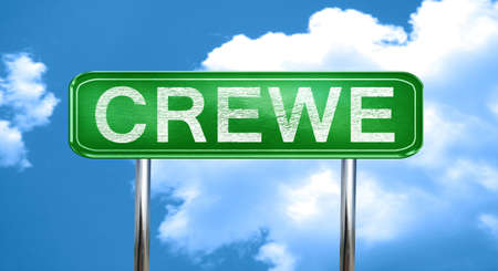 Crewe city, green road sign on a blue background 写真素材
