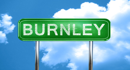 burnley: Burnley city, green road sign on a blue background