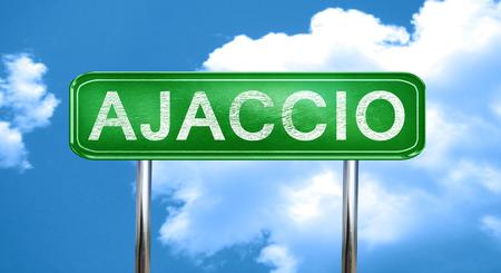 ajaccio: ajaccio city, green road sign on a blue background