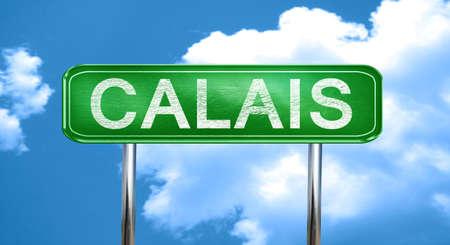calais: calais city, green road sign on a blue background