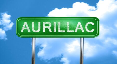 aurillac: aurillac city, green road sign on a blue background