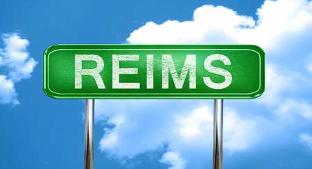 reims city, green road sign on a blue background