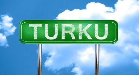turku: Turku city, green road sign on a blue background Stock Photo