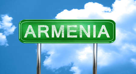 armenia: Armenia city, green road sign on a blue background Stock Photo