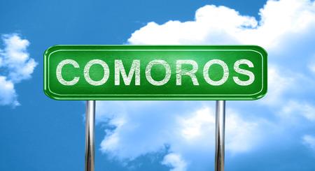 comoros: Comoros city, green road sign on a blue background Stock Photo