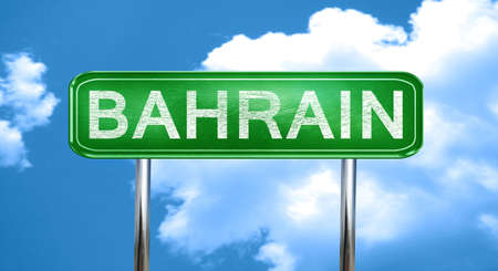 bahrain: Bahrain city, green road sign on a blue background Stock Photo