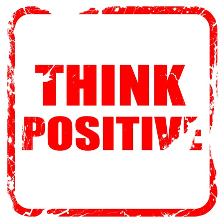 strong message: think positive, red rubber stamp with grunge edges Stock Photo