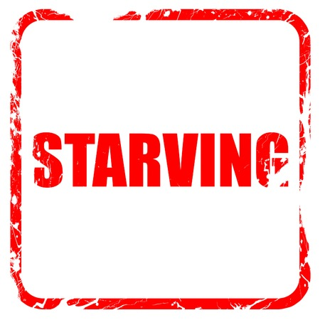 starving: starving, red rubber stamp with grunge edges Stock Photo