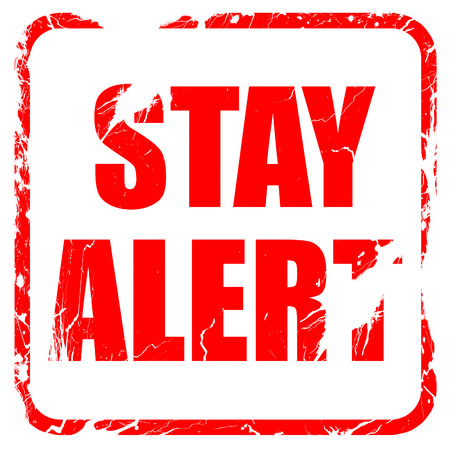 stay alert: stay alert, red rubber stamp with grunge edges Stock Photo