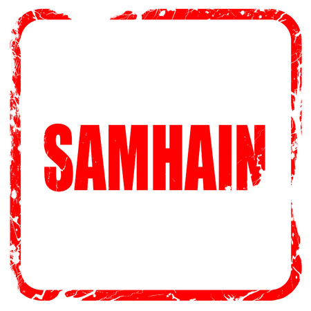 samhain: Traditional glowing Samhain Jack-o-Lantern with carved word Samhain on it. Pagan Wiccan Wheel of the Year holiday celebration., red rubber stamp with grunge edges Stock Photo