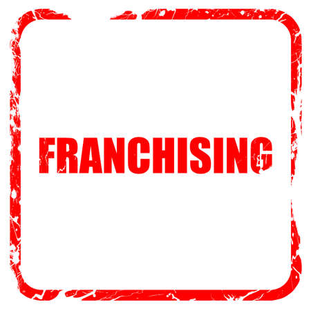 franchising: franchising, red rubber stamp with grunge edges