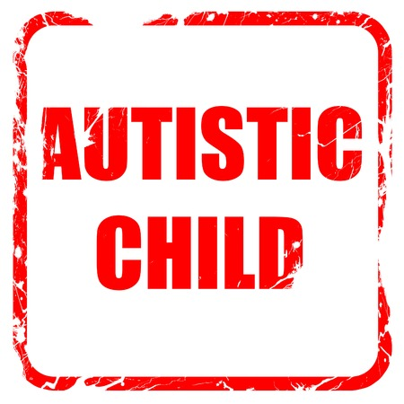 autistic: Autistic child sign with orange and black colors, red rubber stamp with grunge edges Stock Photo