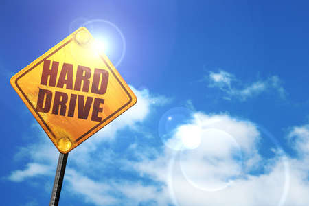 harddrive: harddrive, 3D rendering, glowing yellow traffic sign Stock Photo