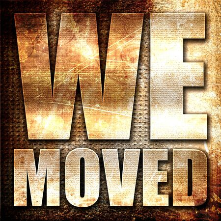 we moved, 3D rendering, metal text on rust background Stock Photo