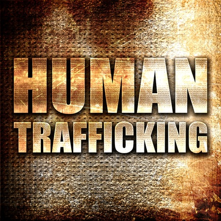clandestine: human trafficking, 3D rendering, metal text on rust background