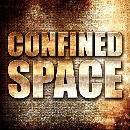 confined space: confined space, 3D rendering, metal text on rust background Stock Photo