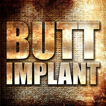butt implant, 3D rendering, metal text on rust background Stock Photo